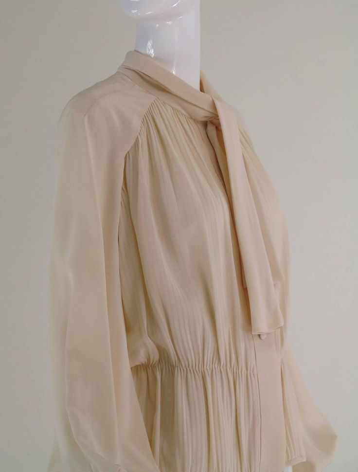 Pierre Balmain Haute Couture cream silk pleated tie neck blouse 1950s | From a collection of rare vintage shirts at https://www.1stdibs.com/fashion/clothing/shirts/