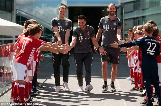 Goalkeepers Manuel Neuer, Sven Ulreich and Tom Starke arrive for the Audi car…