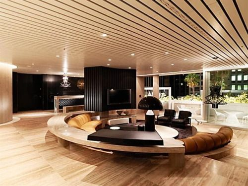 A sunken living room with a spherical sofa. Yum!