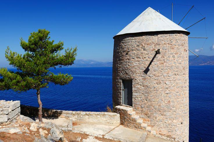 Windmill overlooking the sea in Hydra island, Greece