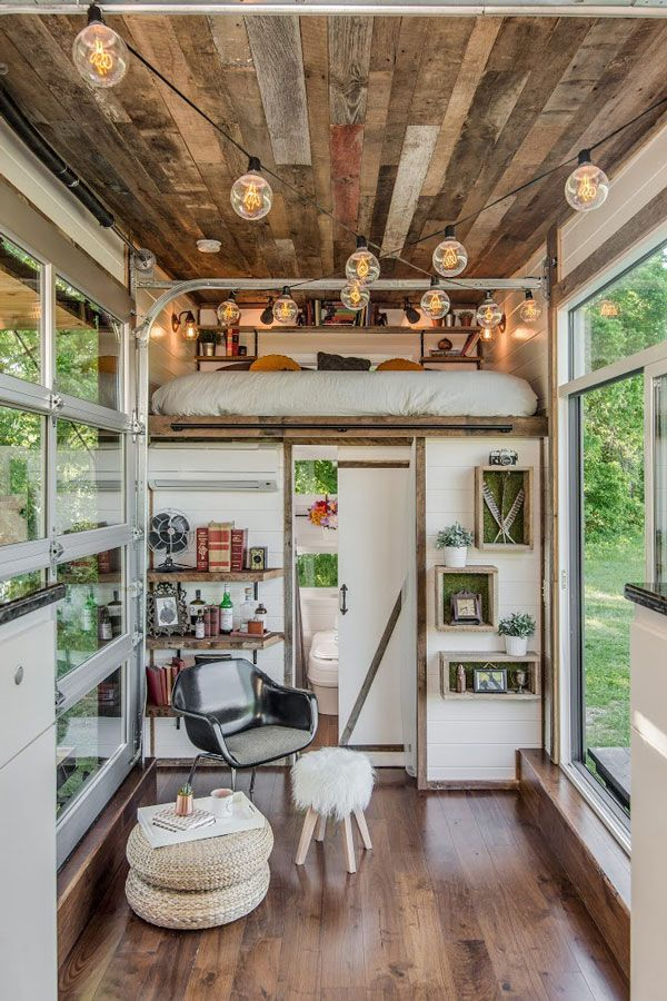 This Gorgeous Tiny House Is Proof That Size Doesn't Matter #refinery29  http://www.refinery29.com/2016/08/118903/new-frontier-alpha-tiny-home#slide-2  The inside is filled with reclaimed barn wood for a rustic yet sophisticated look....