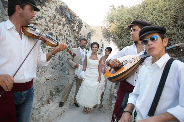 The bride walked to the #santorini_church while greek musicians played #greek_wedding_songs. See more http://www.love4wed.com/santorini-wedding/