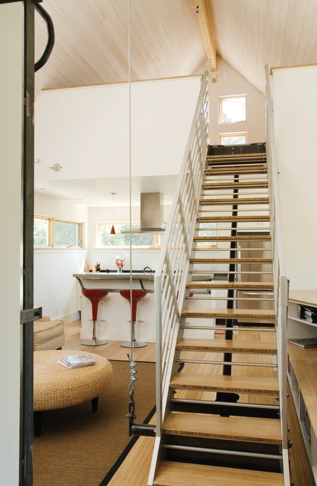 Space is at a maximum in this small urban infill home in Bozeman, Montana. To keep the second floor open but allow access to a third-floor loft, the architects at Intrinsik Architecture designed a counterbalanced steel staircase that can be easily pulled down or pushed up with minimal effort by the residents.
