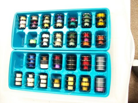 """QuiltFrog says, """"Standard size ice cube trays, are a perfect place to store and keep your large """"M"""" Size bobbins organized."""""""