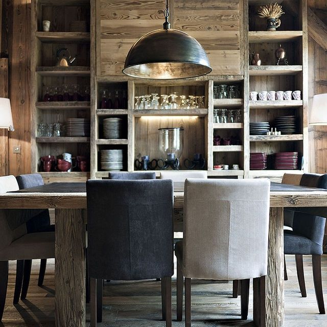 Love the square table with two chairs each side. The two color chairs, the full dining wall for dish storage. The other end of this room could be kitchen with all lower cabinets and no uppers and all dish storage on dining end.