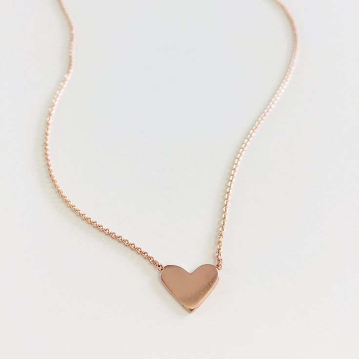 $375 rosegold heart in 14k  Designed for the contemporary playful soul. It will quickly become a cherished daily classic.   Beautiful, thoughtful, soulful. A contemporary take on a timeless favourite. Limited edition addition to our Be Adorned fine jewelry collection.   Solid 14 karat  gold pendant and chain - available in rosegold or yellow gold. Designed and handmade by me with love in Vancouver.