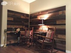#HomeDécor, #LivingRoom, #PalletWall, #RecyclingWoodPallets Isn't this Cozy Pallet Reading Nook much more charming and inviting than a faux fireplace? We decided to ditch the cold, uninviting faux fireplace and updated to create this inviting area in our home.  We used discarded pallets and old fence boards