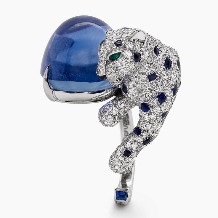 "CARTIER. ""Panthère Insaisissable"" Ring - platinum, one 40.35-carat cabochon sapphire from Sri Lanka, cabochon-cut sapphires, pear-shaped emerald eyes, onyx, brilliant-cut diamonds."