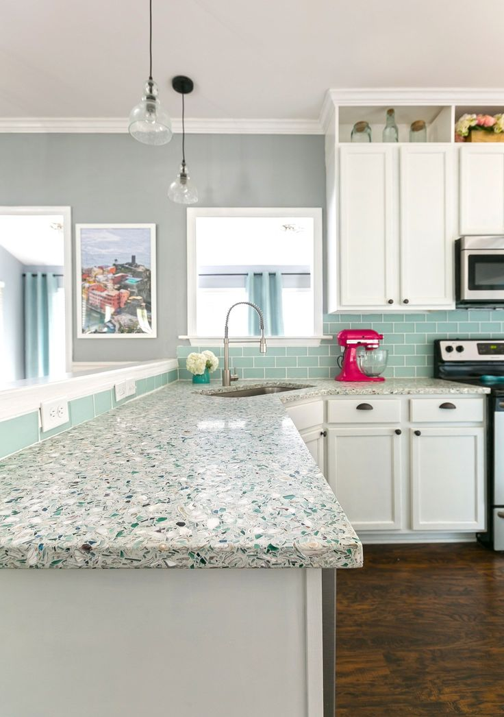DIY Renovated coastal kitchen with light and bright shades of blue and white -  recycled glass and oyster countertops - love this peninsula