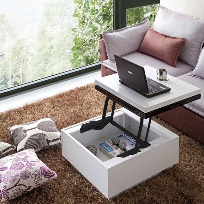This stylish lift-top coffee table is an ideal addition to any room in need of some space-saving furniture. This contemporary coffee table features a sleek high-gloss black-and-white finish that will complement the decor of any modern home.