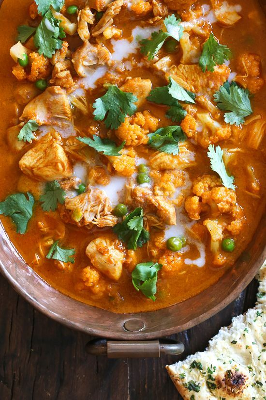 I've created a lightened up, dairy-free Chicken Tikka Masala with Cauliflower and Peas in the Instant Pot to satisfy my craving for Indian food! This mild curry is made with boneless chicken thighs cooked in a tomato base, with lots of spices and coconut milk. You can serve this with garlic naan or basmati rice on the side (cauliflower rice would work too to keep it low carb!)