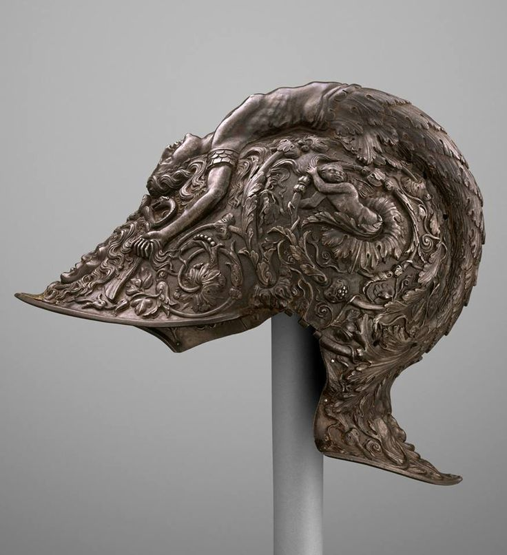 An amazing Italian helmet dated 1543, and created by renowned armorer Filippo Negroli. Currently on view at The Met Fifth Avenue.