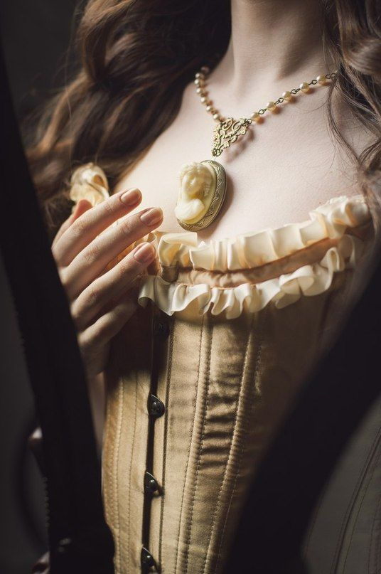.... She admired her knew cameo, hung on a string of pearls delicately wound together with metal. She had never before seen her herself look as splendid as she did then. If only the magic that had transformed her would last as long as she wished..........