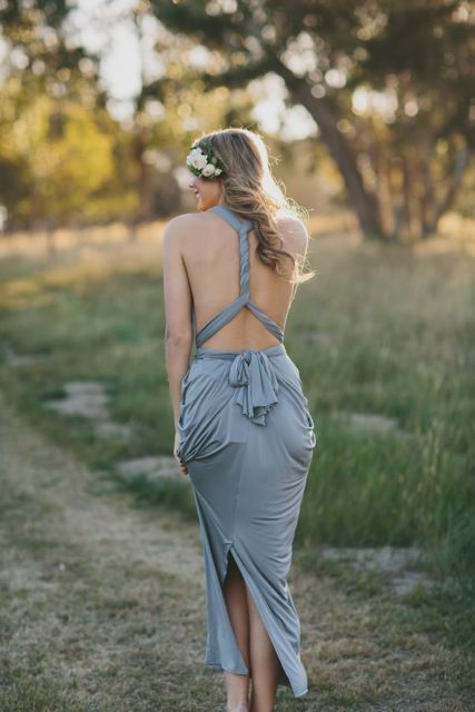 A beautifully draped multi-way dress by Nicolangela. Made of a beautiful poly, spandex blend knit that can be styled over 8 different ways. #whiterunway #multiwaydress #bridesmaids #weddingfashion #weddingflash