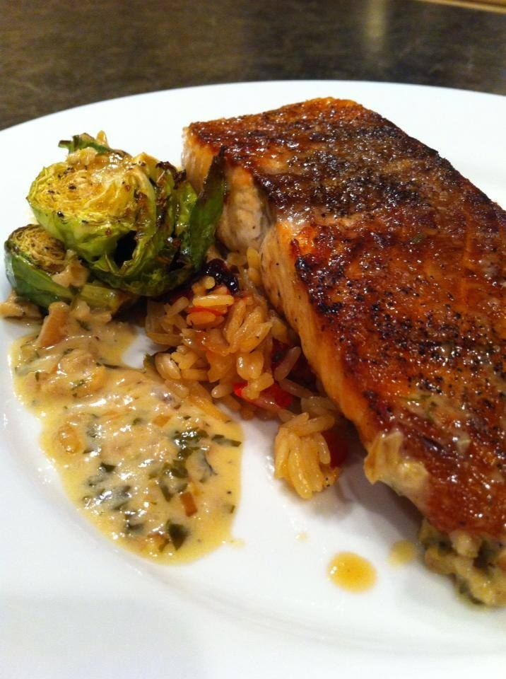 Seared fresh salmon with caramelized brown sugar brussel sprouts, rice pilaf, and a white wine, garlic, cream sauce.