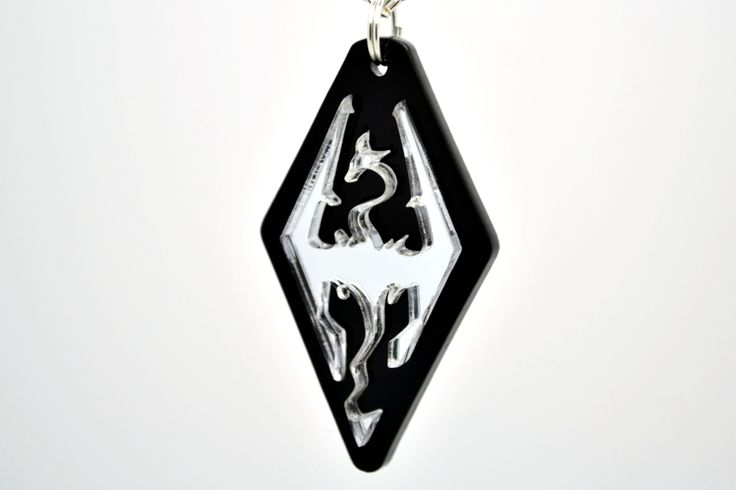 Laser Cut Acrylic Skyrim Dragon Pendant Necklace Back by Popular Demand! We love Elder Scrolls and we've heard that some of you do too :) So we've designed the Elder Scrolls V Skyrim Dragon Pendant Ne