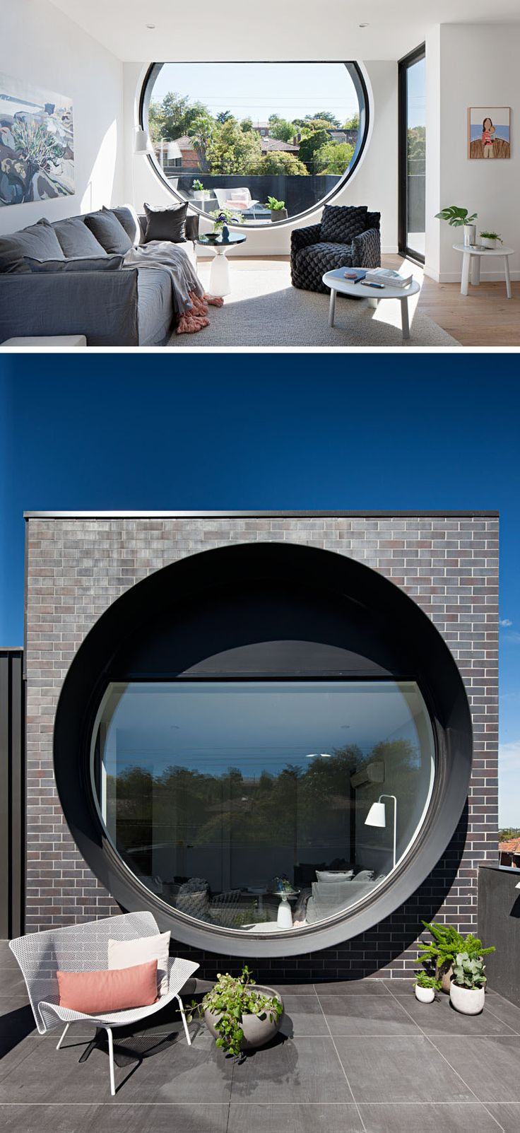 In this modern apartment, the living room is situated next to the large porthole window that provides rooftop views of the surrounding area. Just off the living room is a door that provides access to a small balcony. #Windows #LivingRoom #RoundWindow #Porthole #Architecture #InteriorDesign