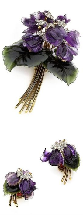 *An amethyst, jade and diamond flower brooch and earclip suite, by Paltscho, circa 1950 The brooch designed as a violet bouquet, the stamens set with single-cut diamonds, to carved amethyst petals, carved nephrite leaves and polished stems, accompanied by a pair of earclips en suite, diamonds approx. 0.40ct total, unsigned, Austrian assay marks, lengths: brooch 7.1cm, earring 3.0cm, maker's cases