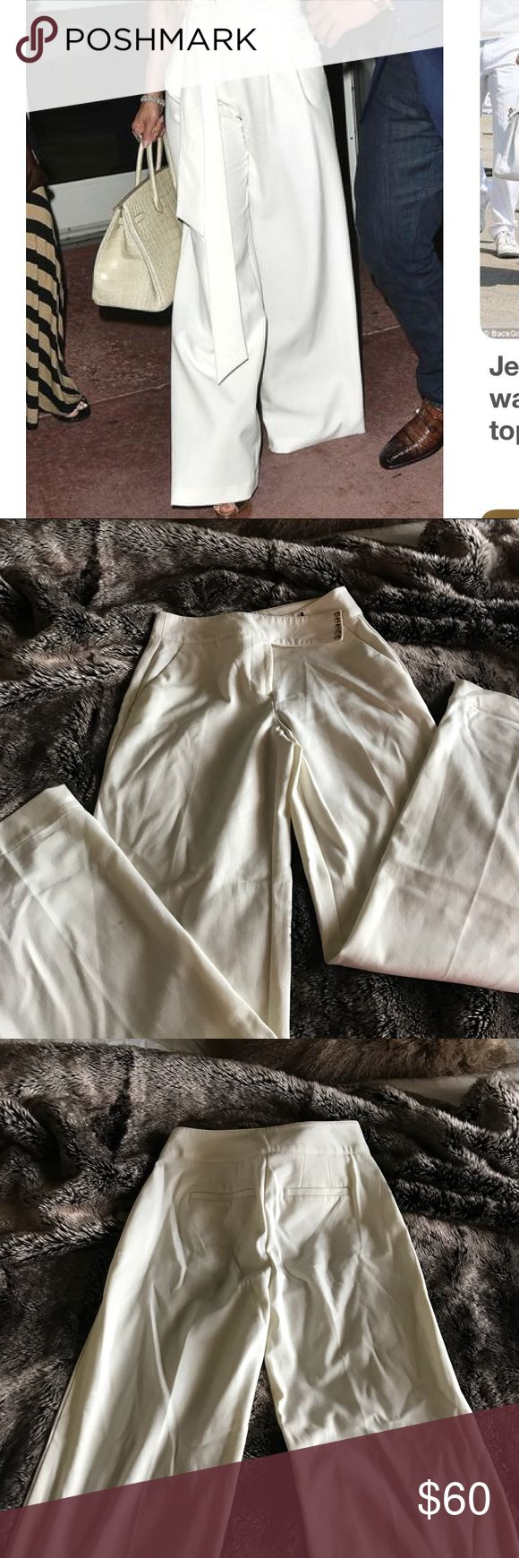 High wasted pants Jenifer Lopez high wasted super extended cuffs. Embroidered belt goes great from work to social Jennifer Lopez Pants Wide Leg
