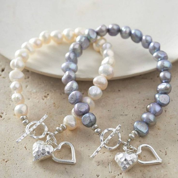 Pearls and silver hearts bracelets