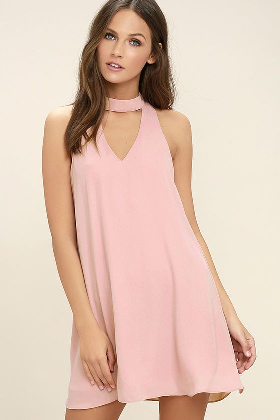 Show 'em how to shake it in the Groove Thing Blush Pink Swing Dress! A mock neck and front cutout top this flirty swing dress composed of lightweight woven poly. Back keyhole with two top clasp closures.