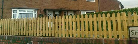 Picket Fence mounted on a brick wall