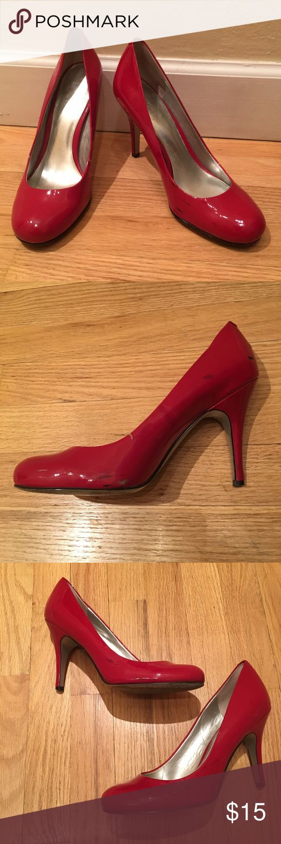 "Jessica Simpson red heels Red pumps. Heel height is 4"". There is a small tear on one shoe and both have black marks throughout from wear. Some wear on heels as well. Price reflects damage. Offers welcome! Jessica Simpson Shoes Heels"