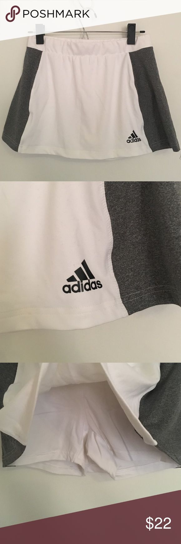 Adidas tennis skort Adidas white and grey tennis skort. Shorts attached. Grey on the sides. Elastic waist band. Really soft material, only worn once!! adidas Shorts Skorts