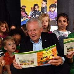 Ruediger Grube and Christina Rau read stories to children in Potsdam