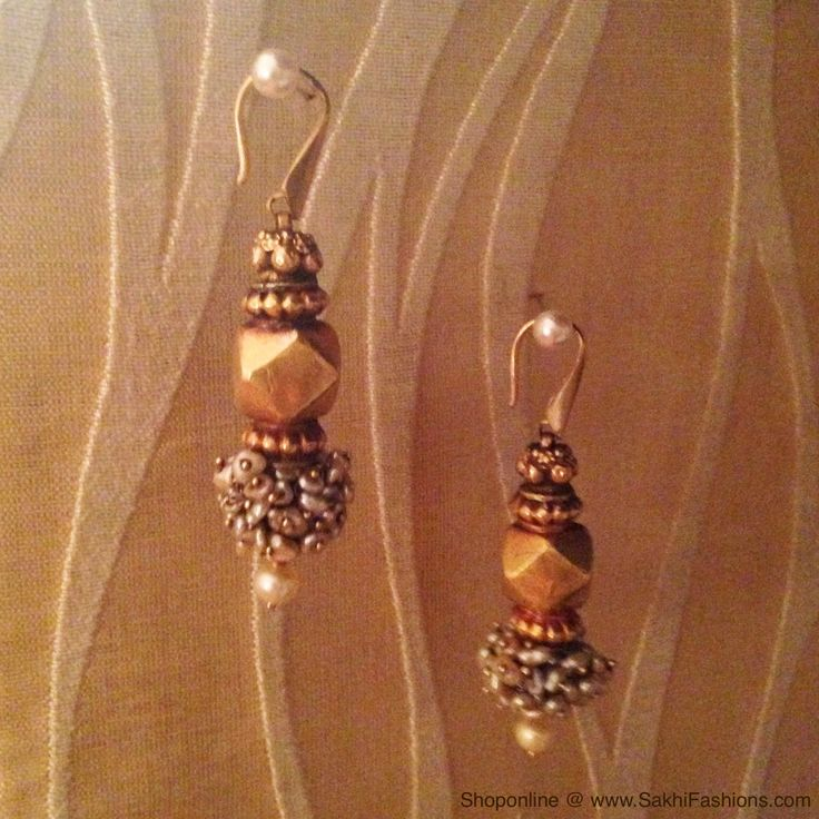 Pure gold and precious pearl handcrafted earrings. http://www.sakhifashions.in/jewellery.html