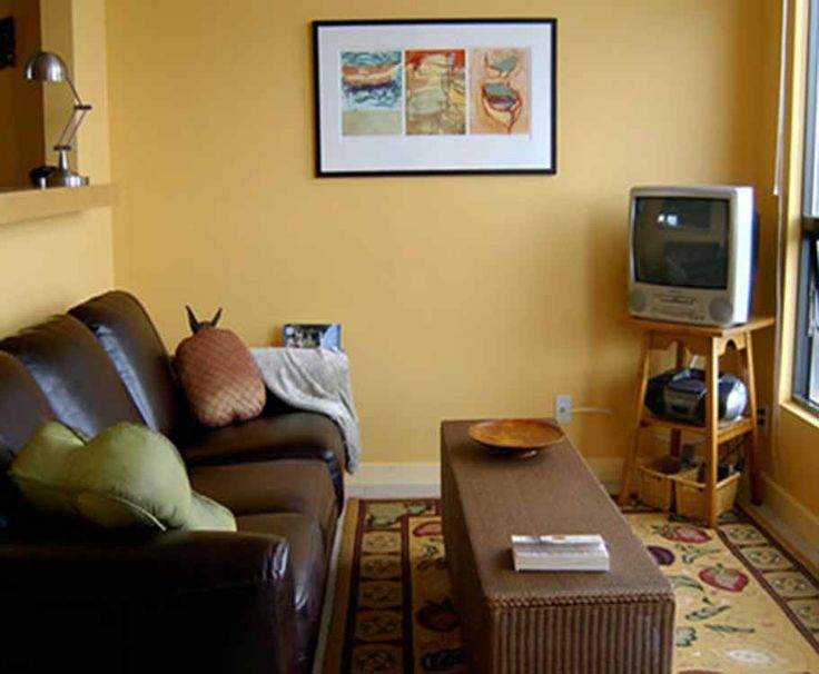 Yellow wall paint color schemes living room with dark for Dark yellow living room
