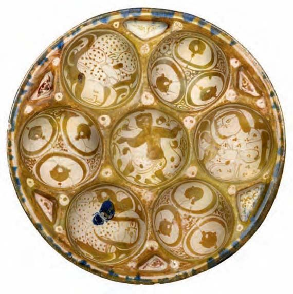 Lusterware mince dish with seven hollows / Iran, late 12th – early 13th century / Fritware, lustre painted on an opaque white glaze, Ø 31.1 cm / Kindly lent by Princess Catherine Aga Khan