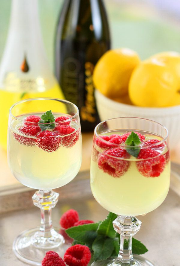 Limoncello and Prosecco with raspberry cubes