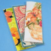 Craft project: Make bookmarks from artwork or drawings that you are willing to cut up.  This is a great way to recycle your less than perfect artwork or preserve your child's teasured drawings.  These bookmarks make great gifts, too!