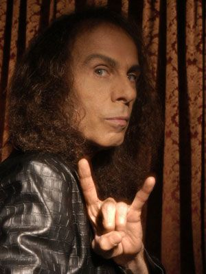 "Ronnie James Dio in a classic ""devil horns"" pose"