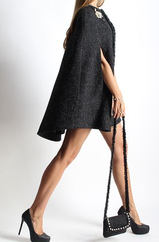 Anna Stevar cape coat. Layer it over a mini dress and over-the-knee boots.