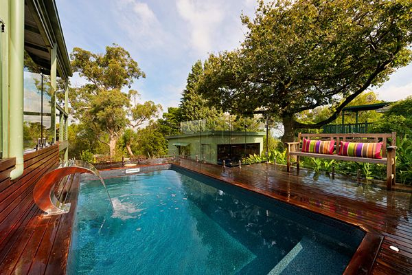 Located in Upwey, Melbourne, this is The Petite Courtyard Series Pool by Albatross Pools. Elevated a metre above natural ground level, this small pool measures 4.0m x 2.0m. Surrounded by pool decking, the swimming pool features the Antique Aqualux pool interior and has a stainless steel water curtain water feature set alongside the pool.