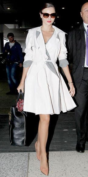 06/03/12: Even on the go, MirandaKerr looked ready for the runway in