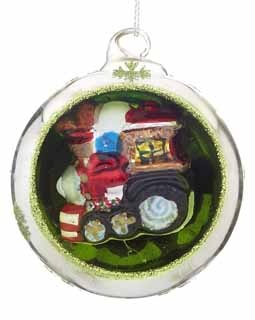 Ornament in an Ornament - Train. All aboard! This train is about to pull out of the train station and head to the North Pole just like the Polar Express! A unique glass ball ornament, this chugging train is hollowed out to have a choo choo ornament encased inside the glass ball outer shell. The outside of the glass ball is silver and the concave inside is lime green with green snowflakes adorning the outside silver and green glittered rim. You can picture the multi-colored train riding down…