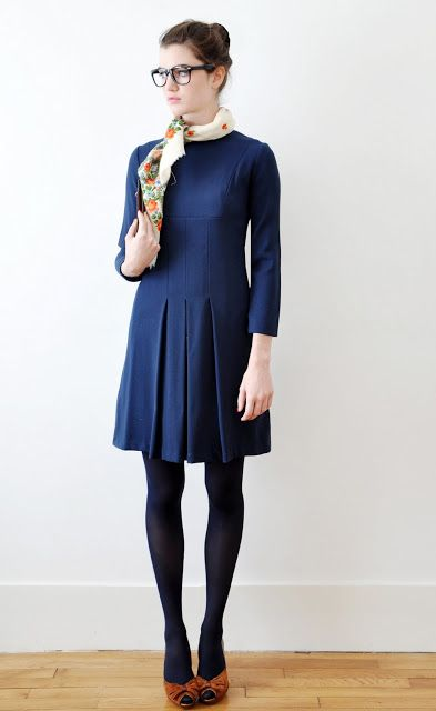 Pair a navy dress or skirt with black tights and shoes and the look is quite fresh and modern. With this look, I treated the navy skirt as if it were any other color, and had black tights and booties anchor it.