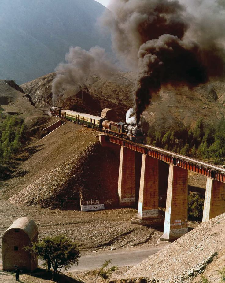Pair of Pakistan Railways HGS steam locomotives take a special train up the Khyber Pass. One locomotive at each end facing away from the train to cope with the zig zags further up the pass.