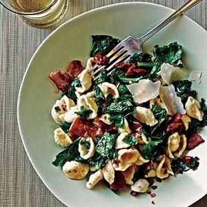 Orecchiette with Kale, Bacon, and Sun-Dried Tomatoes- Add one carton of sliced mushrooms and substitute 1 lb italian sausage links for bacon (roughly chopped after cooking)
