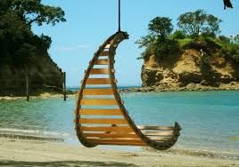 swinging hammock looks comfortable i like the design pattern lets air circulate and lets water drain looks reasonably cheap tropical island design light
