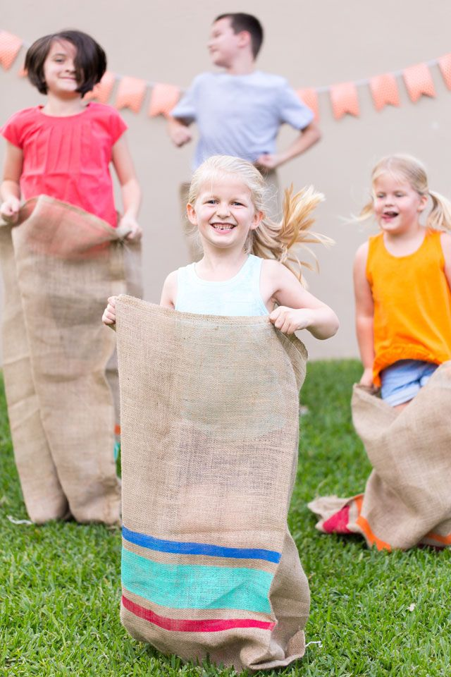 Have a backyard field day party with old school races! Dress up plain potato sacks with colorful painted stripes