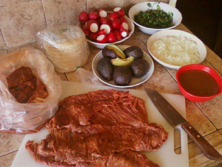 Ingredients: Carne Ranchera preparada, miniature Corn Tortillas, Radishes, Cilantro, Onions, Avocado and homemade Mexican Salsa.