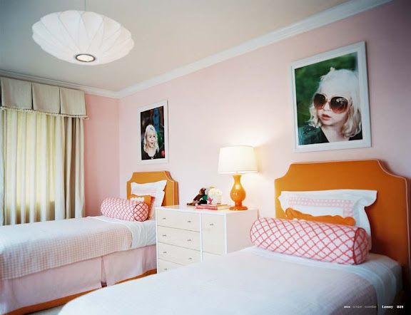 shared girls room... bright, love the LARGE pics over the beds, dresser used as nightstand between