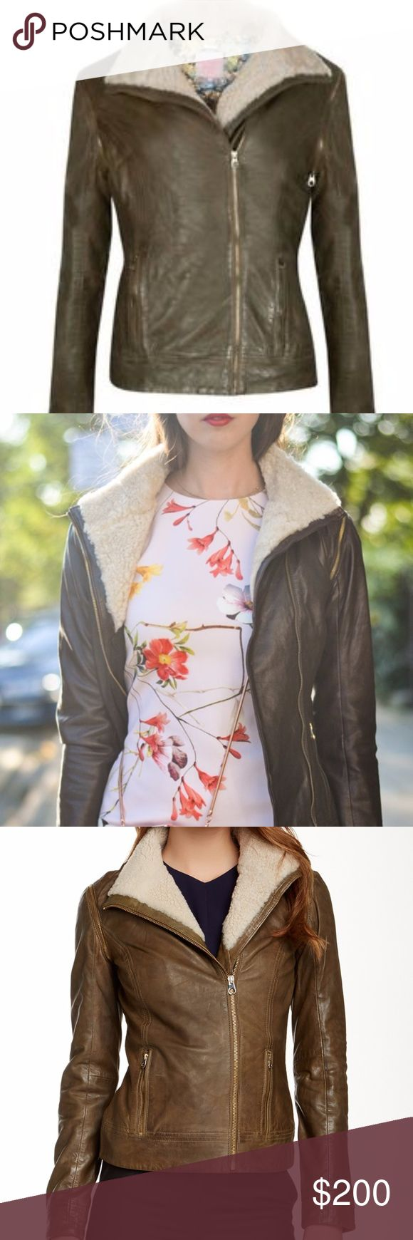 ⚡1 HR SALE⚡Ted Baker Sheep Fur Trim Leather Jacket Olive Green in Color - Fits like a US size 8/10 This incarnation of the classic leather jacket ups the ante with detachable sleeves that transform it into a tailored vest. Leave the piece open to show off the collar's plush sheep fur lining, or zip it up when you're ready to ride. Front asymmetrical zip closure. Front zip pockets. Detachable zip-off sleeves. Lined. Leather with genuine sheep fur Professional leather clean. By Ted Baker…