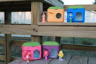 Berry houses for Strawberry Shortcakesmade out of recycled baby formula containers