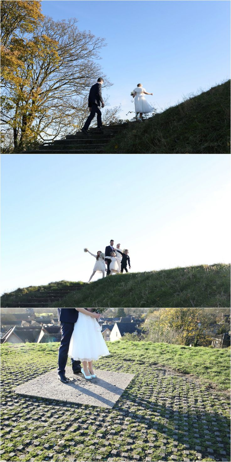 realxed and fun reportage wedding photography in Cambridge, portraits at top of a hill with blue sky, fun with the kids and long shadows