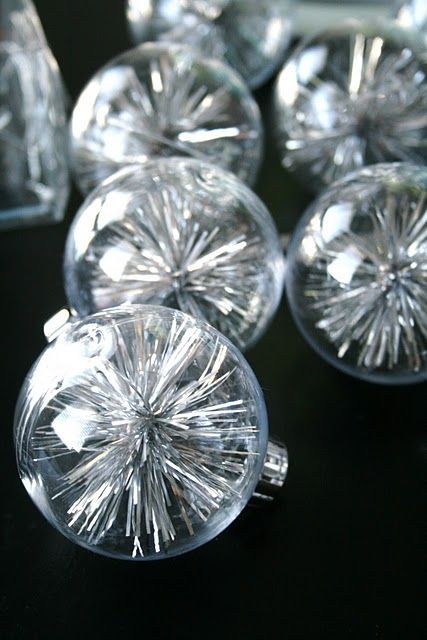 Made from extra tinsel and clear balls. make them small so they can hang deep in the tree with the lights.